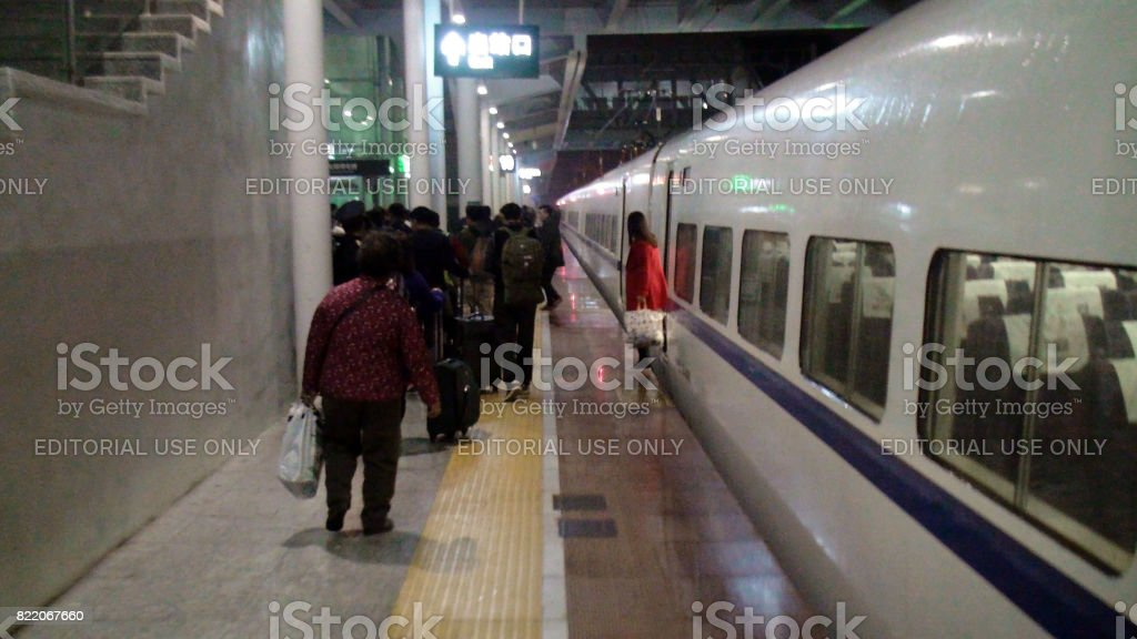 Guilin Train Station In Guangxi Zhuang Autonomous Region And People Departing After Train Arrival In China stock photo