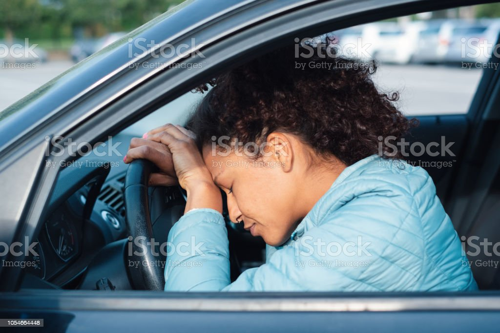 Guilty driver feeling bad after car crash stock photo