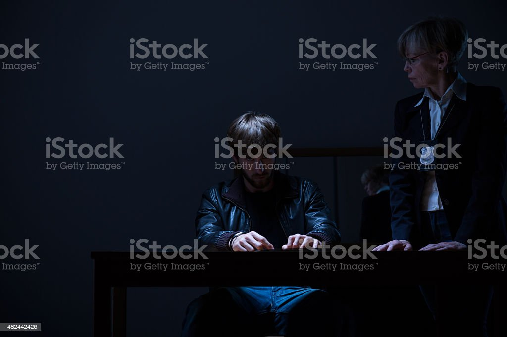 Guilty man and policewoman stock photo