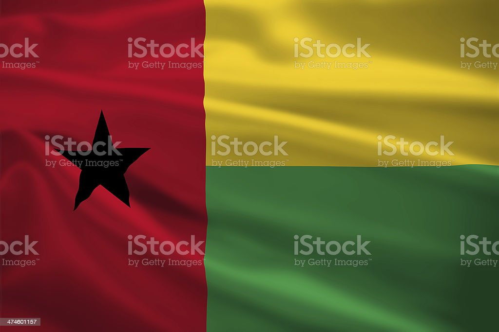 Guinea-Bissau flag blowing in the wind stock photo