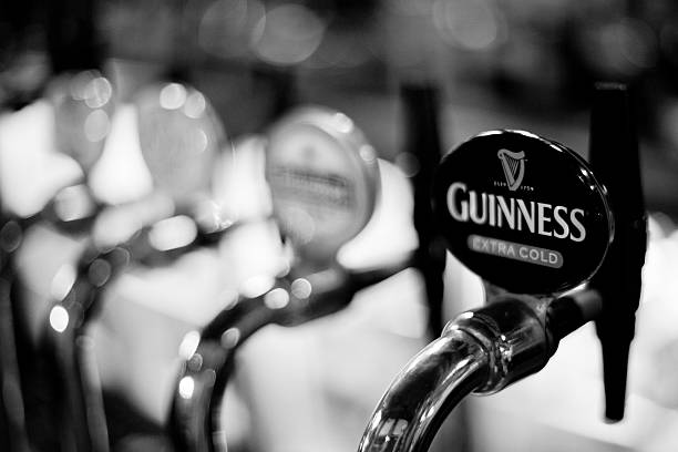 Guinness tap at an English Pub stock photo