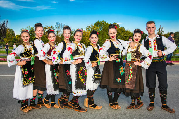guinness world record largest folk dance in novi sad, serbia. - serbia stock photos and pictures