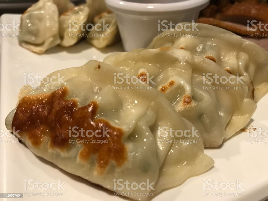 Guioza or pasta with stuffing of beef, beef or pork or vegetables. Asian cuisine dish - foto stock