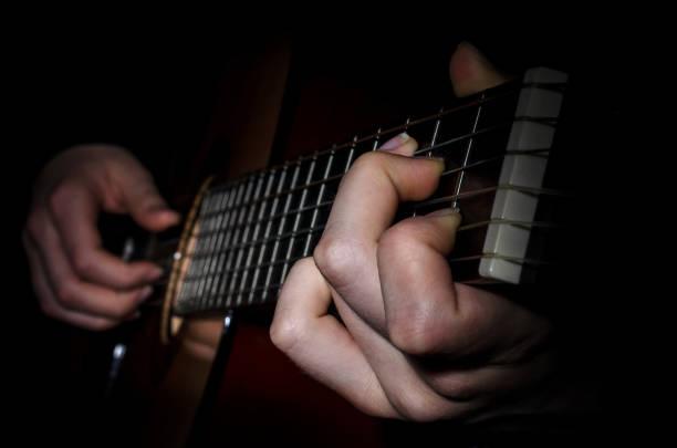 guitar acoustics fingers frets stock photo