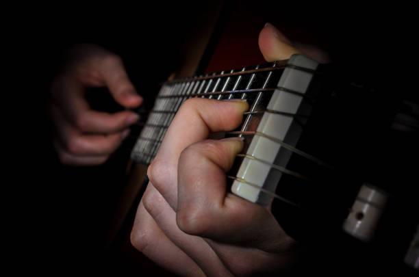 guitar acoustics hand frets stock photo