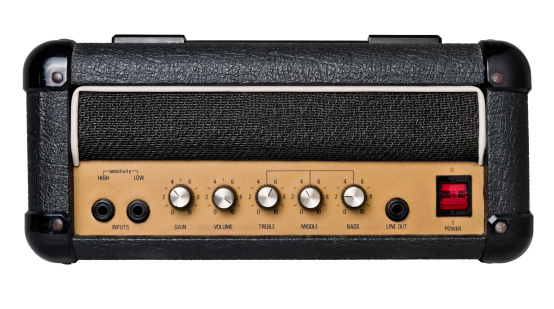 Vintage guitar amplifier head isolated on white.