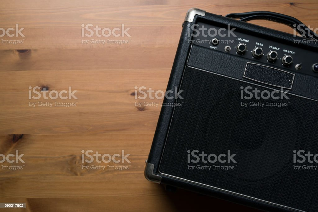 Guitar amplifier on wood table background stock photo