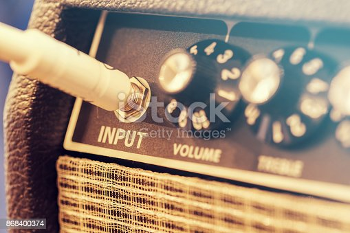 Close-up of switches on music amplifier, vintage