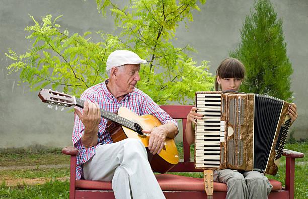 Guitar and accordion stock photo