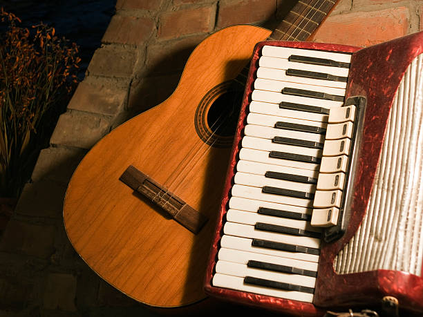 guitar and acordion - accordion stock photos and pictures