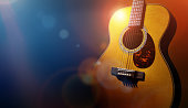 istock Guitar and blank grunge stage background 613766442