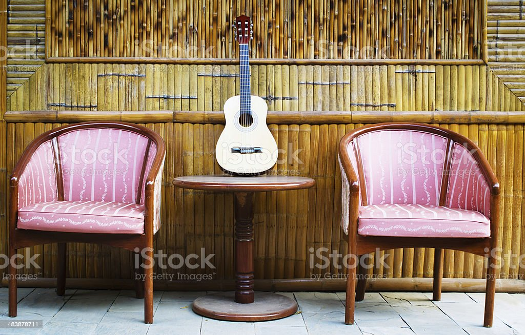 guitar and chairs royalty-free stock photo