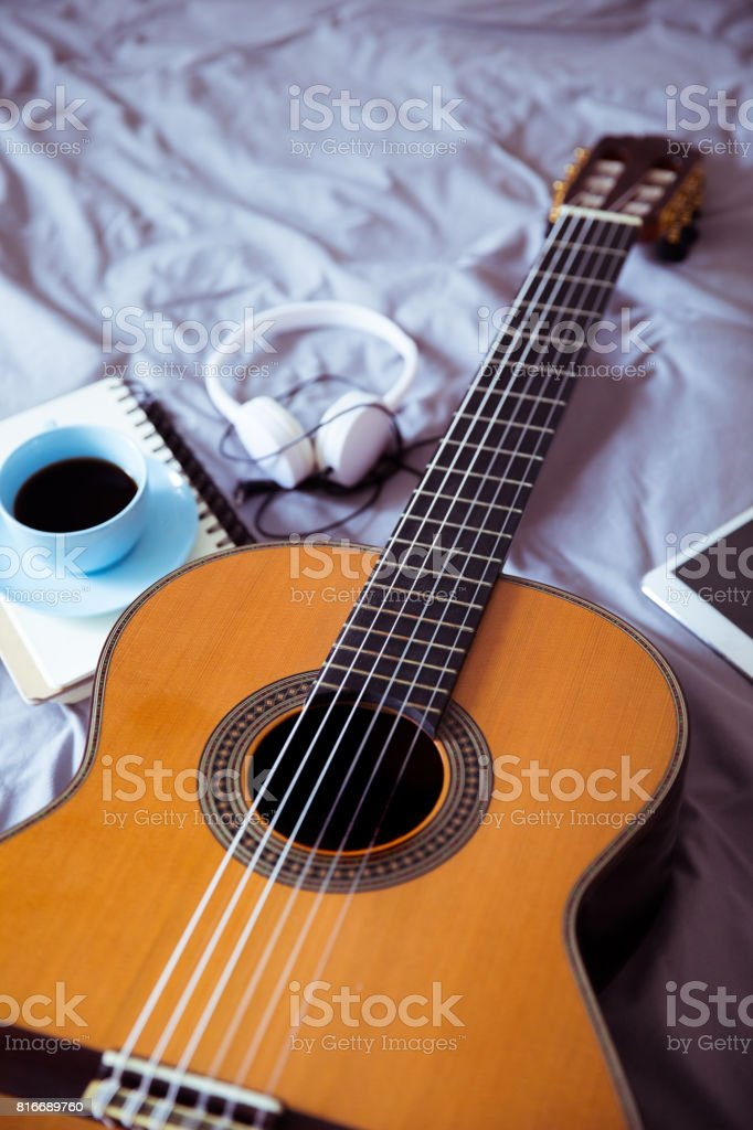 Guitar And Coffee Cup On Bed Stock Photo More Pictures Of Acoustic