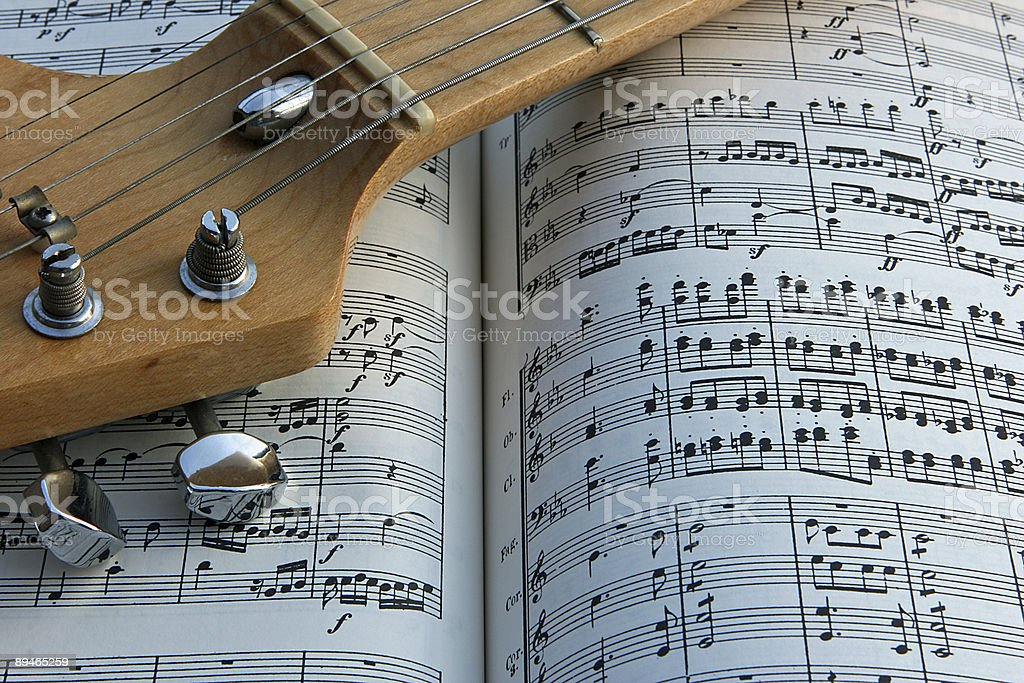 Guitar and notes stock photo