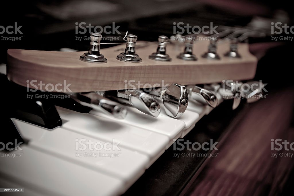 Guitar and piano stock photo