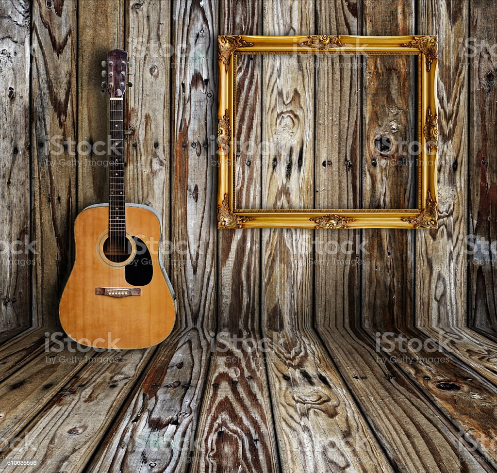 Guitar and picture frame stock photo