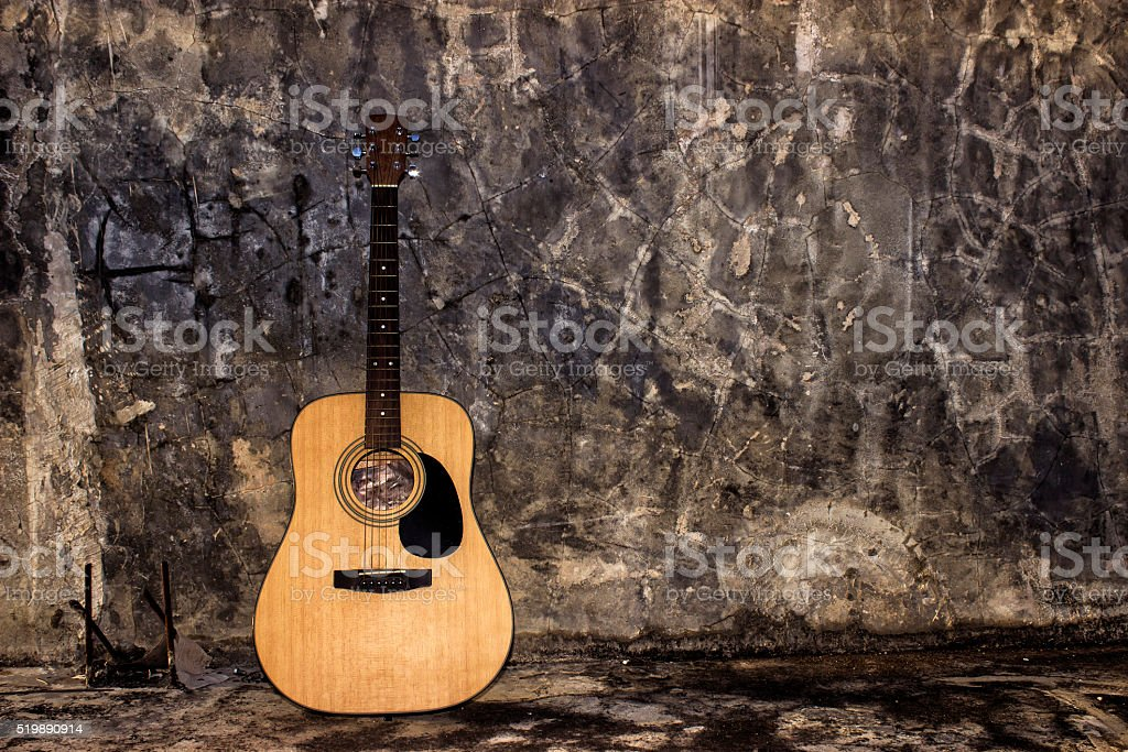 guitar and wall stock photo