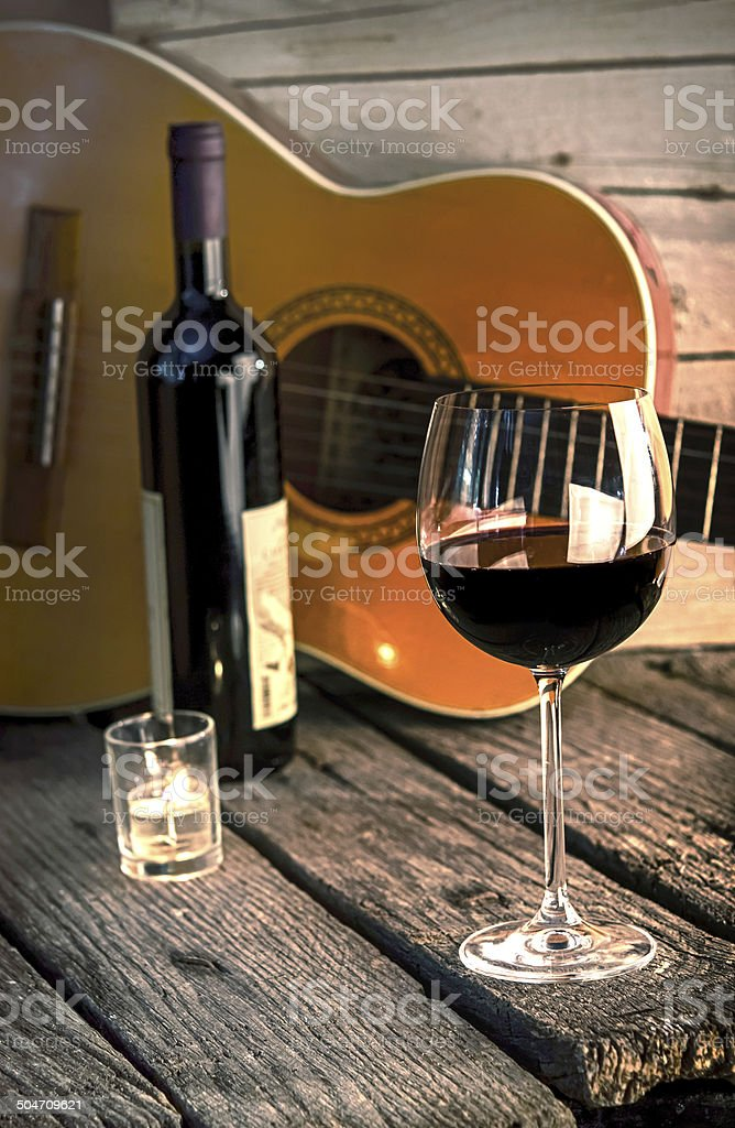 guitar and Wine on a wooden table romantic dinner background stock photo