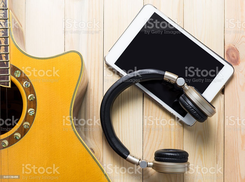 Guitar Blank tablet with headphone for mobile application mock up. stock photo