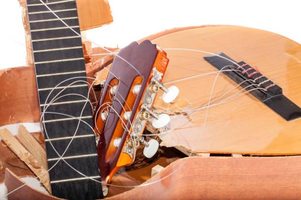 guitar broken into bits and pieces - broken guitar stock photos and pictures