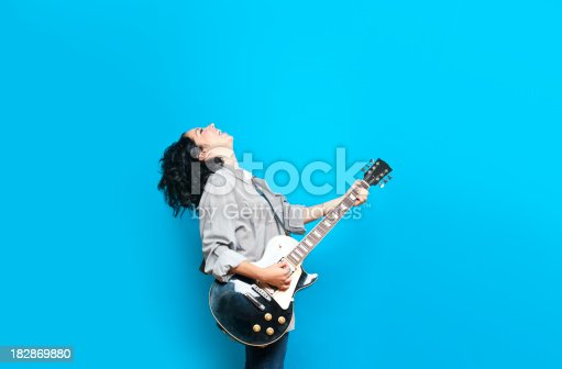 Guitar player against a blue background
