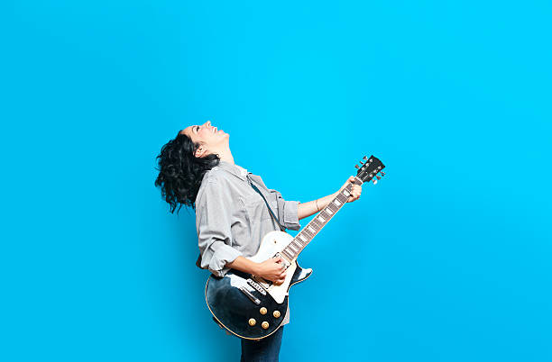 guitar chic - rock music stock pictures, royalty-free photos & images