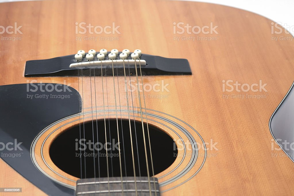 guitar closeup of soundhole, bridge and lower body stock photo