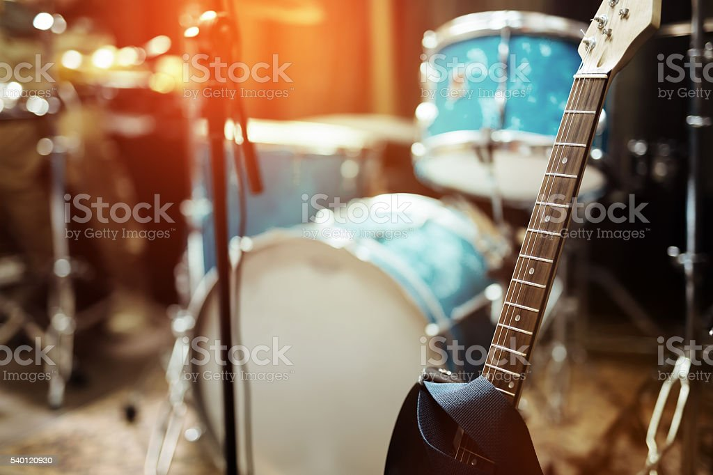 Guitar drums and studio equipment stock photo