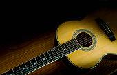 istock Guitar folk on a wooden floor with beautiful light. 1194207923