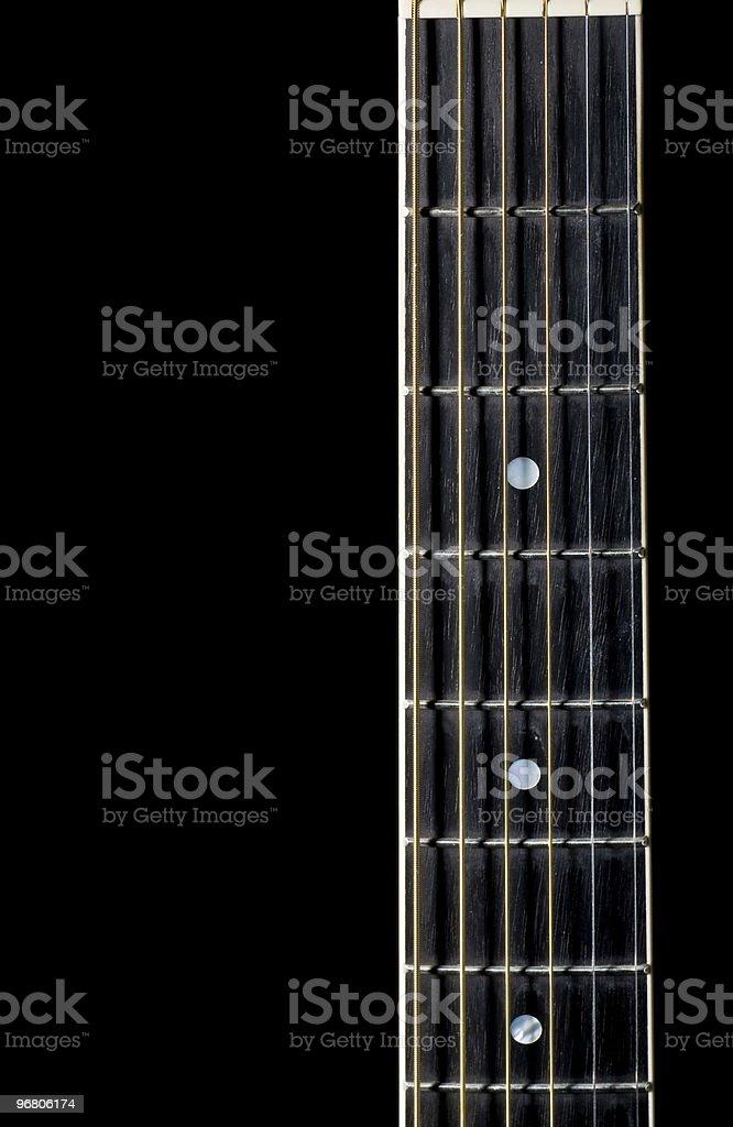 Guitar fret board on black background stock photo