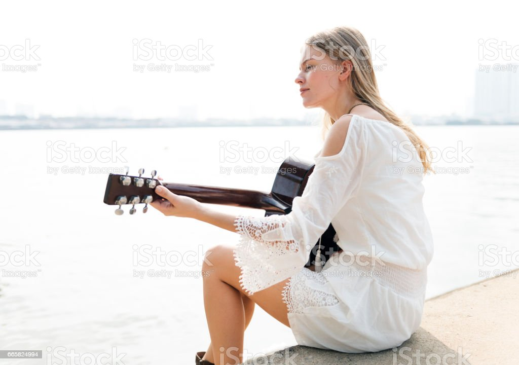 Guitar Girl Relaxation Casual Instrument Leisure Concept stock photo