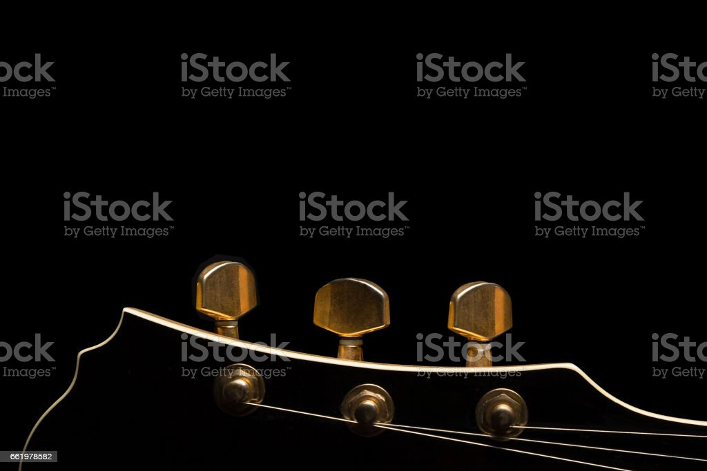 Guitar headstock on black background royalty-free stock photo