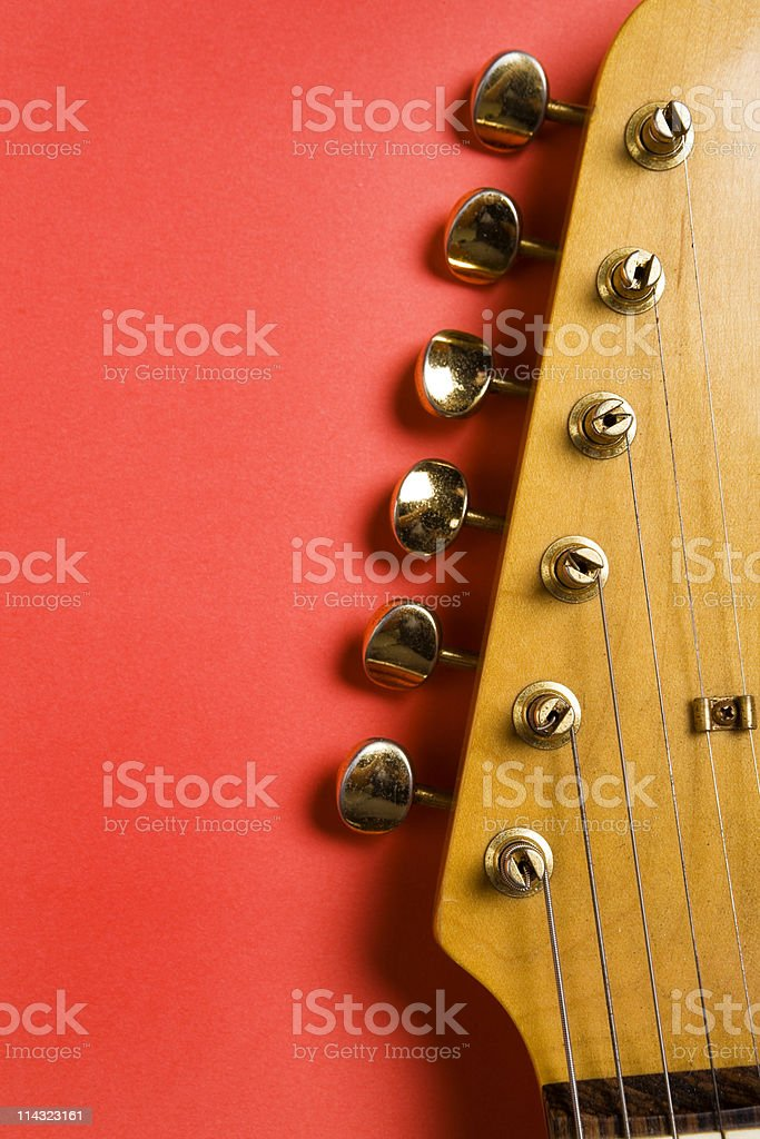 Guitar headstock on red royalty-free stock photo