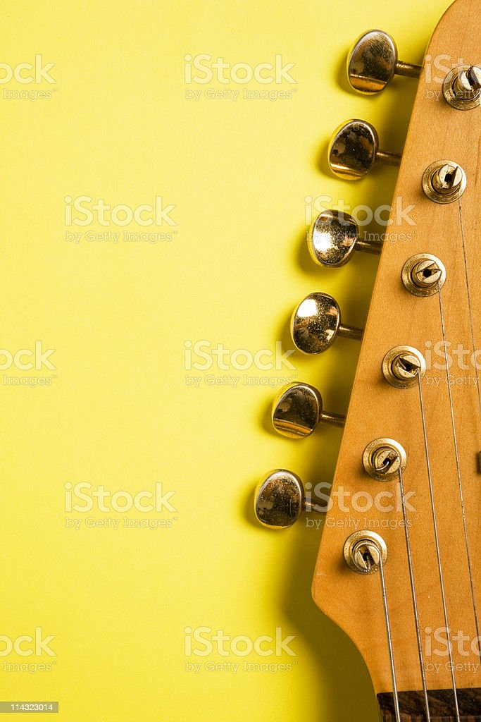 Guitar headstock on yellow royalty-free stock photo