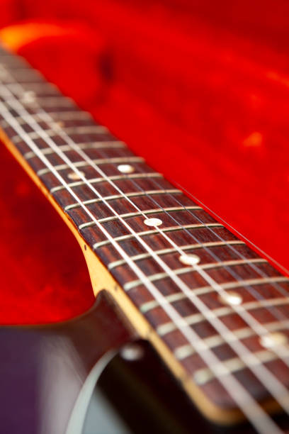 Guitar in red case stock photo