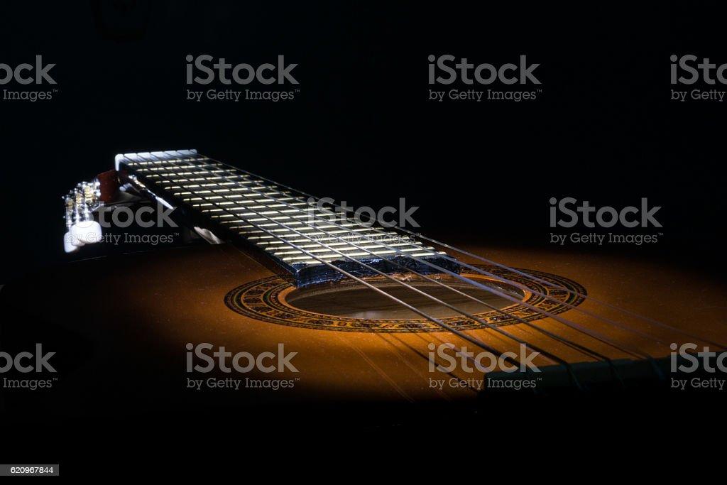 Guitar in the dark stock photo