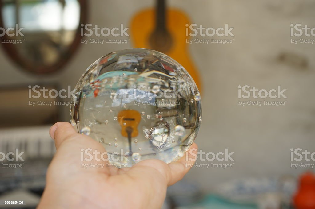 Guitar Instrument though Glass bubble ball royalty-free stock photo