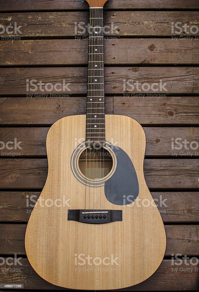 Guitar laying on wood stock photo