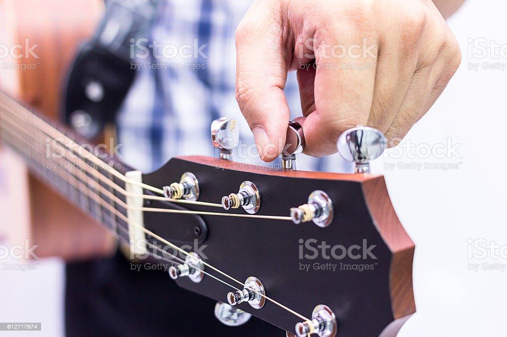 Guitar maintaining stock photo