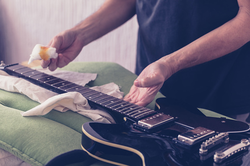 Guitar Maintenance Oiling Fretboard Closeup Stock Photo - Download Image  Now - iStock