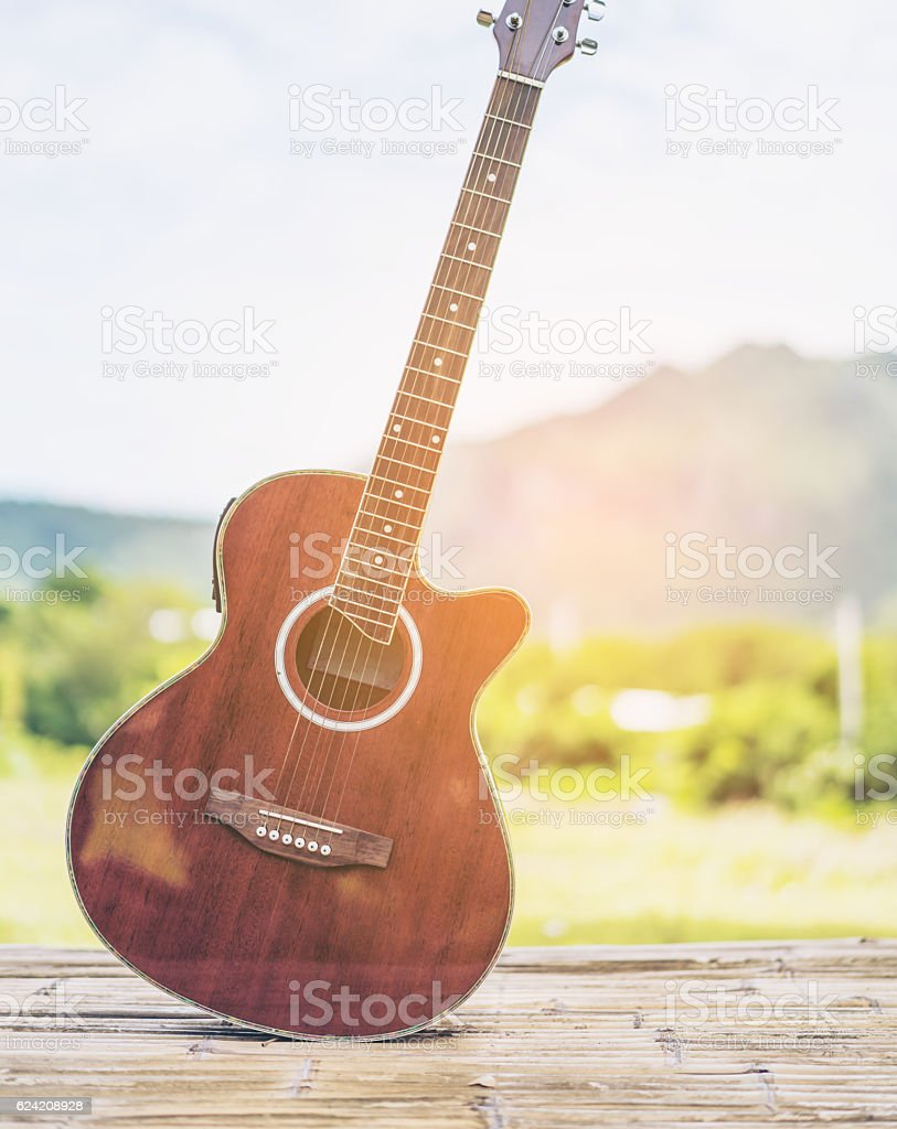 Guitar, nature and mountain background stock photo