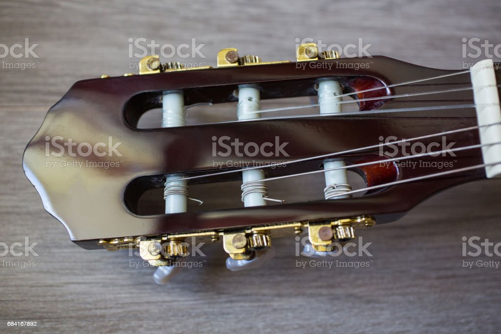 guitar neck on a wooden background, musical instrument, fretboard foto de stock libre de derechos