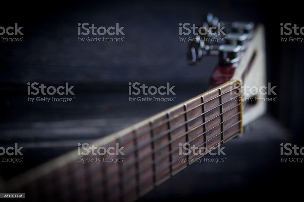 guitar neck on dark background stock photo