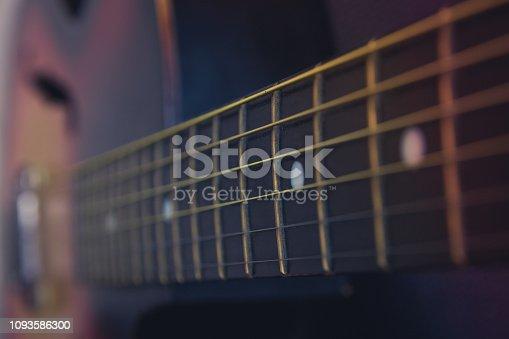 1014432572 istock photo Guitar neck, strings, frets. 1093586300