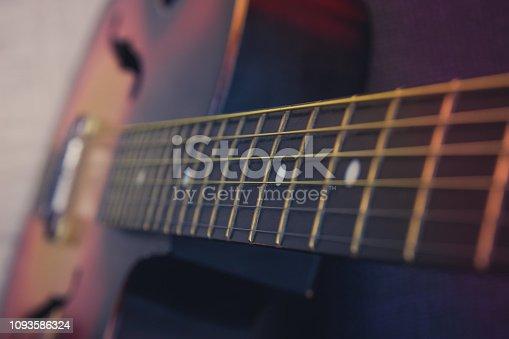 1014432572 istock photo Guitar neck, strings, frets. 1093586324