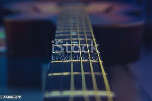 1014432572 istock photo Guitar neck, strings, frets. 1093586372