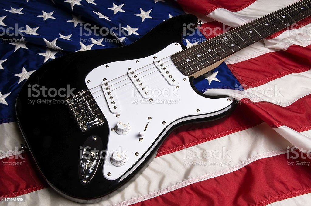 Guitar on American United States Flag stock photo