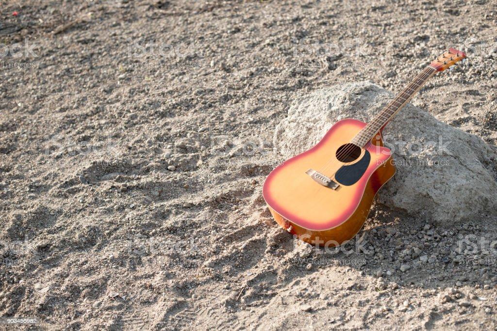 Guitar on beach stock photo