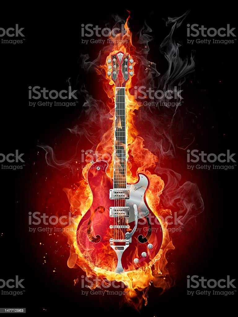 Guitar on fire with black background  stock photo