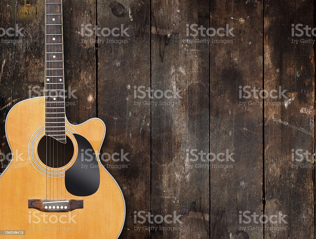 Guitar on rustic wood background stock photo